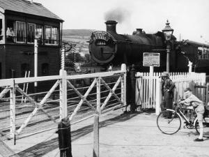 The Cambrian Coast Express Steam Locomotive Train at Llanbadarn Crossing Near Aberystwyth Wales