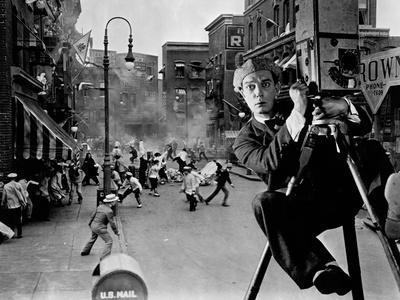 https://imgc.allpostersimages.com/img/posters/the-cameraman-1928_u-L-Q10TUIN0.jpg?artPerspective=n