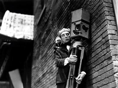 https://imgc.allpostersimages.com/img/posters/the-cameraman-buster-keaton-1928_u-L-Q12PEYA0.jpg?artPerspective=n