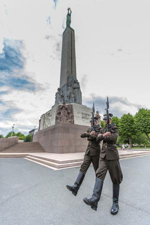 https://imgc.allpostersimages.com/img/posters/the-changing-of-the-guard-at-the-monument-of-freedom-riga-latvia-europe_u-L-PQ8NMN0.jpg?p=0