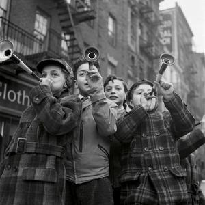 Blowing horns on Bleeker Street by The Chelsea Collection