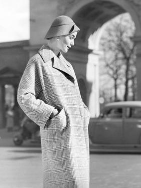 Young Woman In Winter Coat And Hat, 1956 by The Chelsea Collection