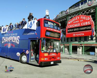 The Chicago Cubs raise World Series trophy during the 2016 victory parade on 11/4/16 in Chicago