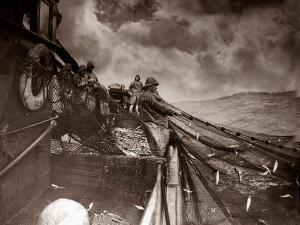 The Crew of a Yarmouth Herring Boat Pull in Their Catch on a Storm Tossed North Sea, 1935