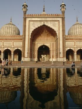 The Domes and Facade of the Jama Masjid Reflected in a Pool