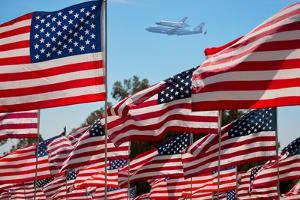 The final flight of the Space Shuttle Columbia flies on 9/21/12 over US Flags at Peperdine Unive...