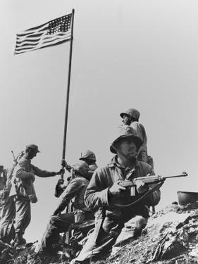 The First Flag Raising on Iwo Jima's Mount Suribachi