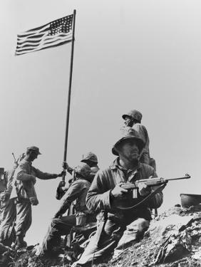 The First Flag Raising on Iwo Jima's Mount Suribachi