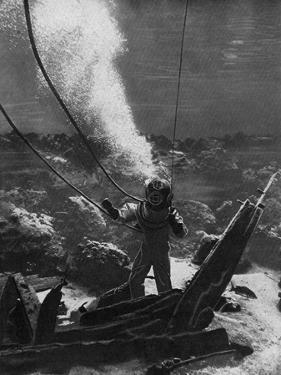 The First Photograph of a Diver under Water, Late 19th Century