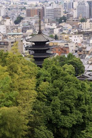 https://imgc.allpostersimages.com/img/posters/the-five-tiered-pagoda-of-to-ji-looks-out-over-the-modern-city-of-kyoto-japan_u-L-Q12TA930.jpg?p=0