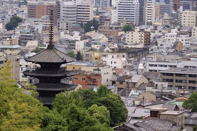 https://imgc.allpostersimages.com/img/posters/the-five-tiered-pagoda-of-to-ji-looks-out-over-the-modern-city-of-kyoto-japan_u-L-Q12TAA10.jpg?p=0