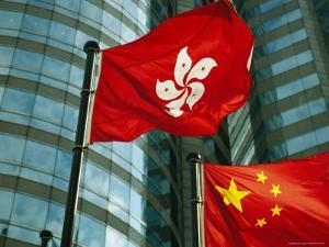 The Flag of Hong Kong Next to a Peoples Republic of China Flag