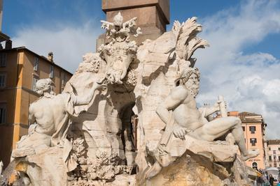 https://imgc.allpostersimages.com/img/posters/the-fountain-of-the-four-rivers-piazza-navona-rome-lazio-italy-europe_u-L-PQ8O8Z0.jpg?p=0