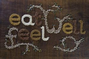 The Phrase 'Eat Well, Be Well', Written And Decorated In Seeds by The Full 360