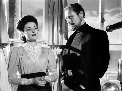 https://imgc.allpostersimages.com/img/posters/the-ghost-and-mrs-muir-gene-tierney-costume-designed-by-oleg-cassini-rex-harrison-1947_u-L-PH3NGW0.jpg?artPerspective=n
