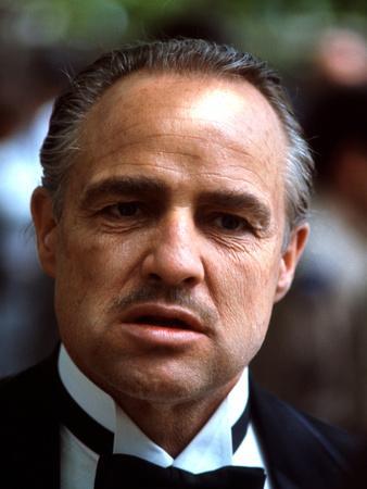 https://imgc.allpostersimages.com/img/posters/the-godfather-marlon-brando-1972_u-L-Q1BUBQC0.jpg?artPerspective=n