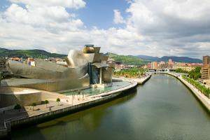 The Guggenheim Museum of Contemporary Art of Bilbao (Bilbo) on the river Ibaizabal, located on t...