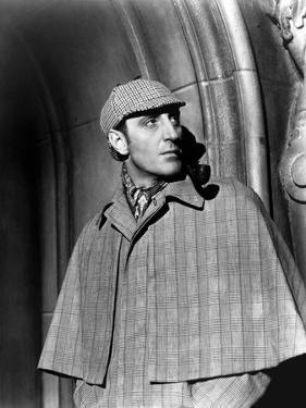 THE HOUND OF THE BASKERVILLES, 1939 directed by SIDNEY LANFIELD. Basil Rathbone (b/w photo)