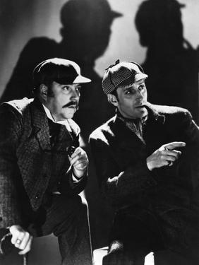 THE HOUND OF THE BASKERVILLES, 1939 directed by SIDNEY LANFIELD. Nigel Bruce and Basil Rathbone (b/