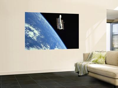 https://imgc.allpostersimages.com/img/posters/the-hubble-space-telescope-with-a-blue-earth-in-the-background_u-L-PFHCS20.jpg?artPerspective=n