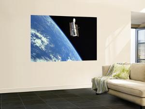 The Hubble Space Telescope with a Blue Earth in the Background