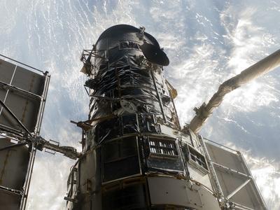https://imgc.allpostersimages.com/img/posters/the-hubble-space-telescope_u-L-PJ3KWY0.jpg?artPerspective=n