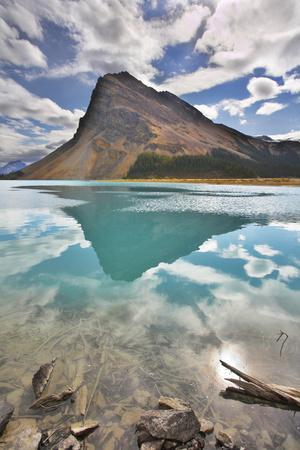 https://imgc.allpostersimages.com/img/posters/the-huge-rock-of-the-triangular-form-is-reflected-in-emerald-waters-of-cold-mountain-lake_u-L-Q1037TZ0.jpg?p=0