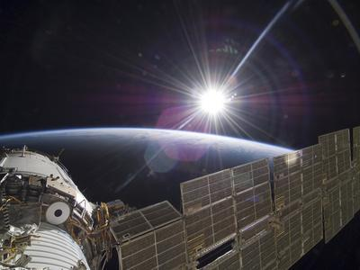 https://imgc.allpostersimages.com/img/posters/the-international-space-station-backdropped-by-the-bright-sun-over-earth-s-horizon_u-L-PJ1TMW0.jpg?artPerspective=n