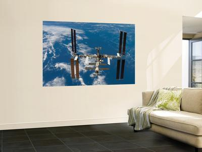 https://imgc.allpostersimages.com/img/posters/the-international-space-station-moves-away-from-the-space-shuttle-atlantis-june-19-2007_u-L-PFHCWE0.jpg?artPerspective=n
