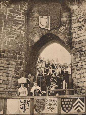 https://imgc.allpostersimages.com/img/posters/the-investiture-of-the-prince-of-wales-at-caernarvon-castle-13-july-1911-1935_u-L-Q1EF9HM0.jpg?artPerspective=n