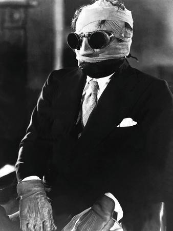 https://imgc.allpostersimages.com/img/posters/the-invisible-man-claude-rains-1933_u-L-PH5IKP0.jpg?artPerspective=n