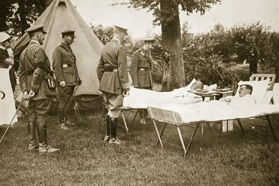 https://imgc.allpostersimages.com/img/posters/the-king-conversing-with-wounded-officers-1916_u-L-PPQJUB0.jpg?p=0