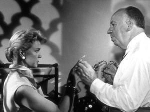 THE MAN WHO KNEW TOO MUCH, 1956 On the set, Alfred Hitchcock directs Doris Day (b/w photo)