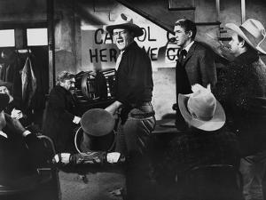 THE MAN WHO SHOT LIBERTY VALANCE, 1962 directed by JOHN FORD John Wayne and James Stewart (b/w phot