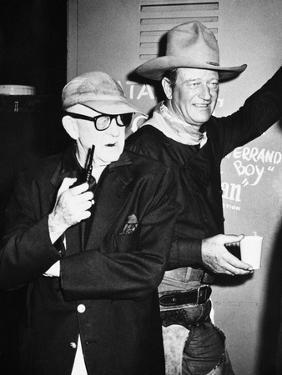 THE MAN WHO SHOT LIBERTY VALANCE, 1962 directed by JOHN FORD On the set, John Ford with John Wayne