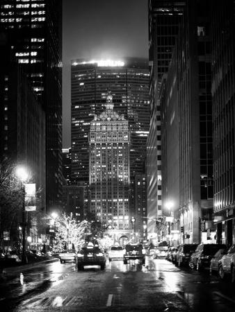 https://imgc.allpostersimages.com/img/posters/the-metlife-building-towers-over-grand-central-terminal-by-night_u-L-PZ3HWA0.jpg?p=0