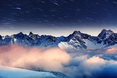 https://imgc.allpostersimages.com/img/posters/the-milky-way-over-the-winter-mountains-landscape-europe-creative-collage-beauty-world_u-L-Q105HXS0.jpg?artPerspective=n