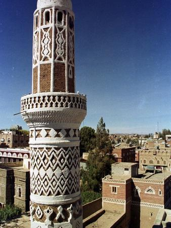 https://imgc.allpostersimages.com/img/posters/the-minaret-of-a-15th-century-mosque-rises-above-a-san-a-yemen-neighborhood_u-L-Q10ON7V0.jpg?artPerspective=n