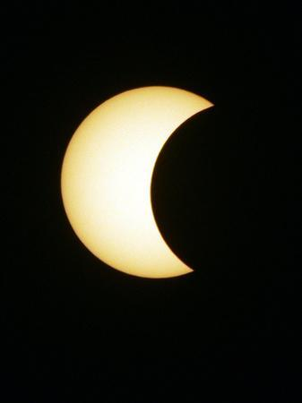 https://imgc.allpostersimages.com/img/posters/the-moon-partially-covers-the-sun-during-the-peak-of-an-annular-eclipse-seen-from-tel-aviv_u-L-Q10OS620.jpg?p=0