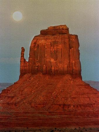 https://imgc.allpostersimages.com/img/posters/the-moon-rises-over-a-butte-known-at-the-mitten-at-monument-valley-navajo-tribal-park_u-L-Q10OVBW0.jpg?p=0