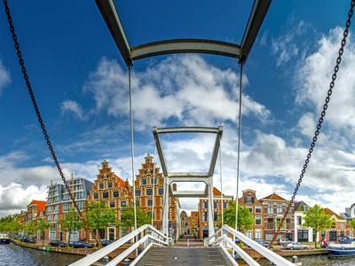 https://imgc.allpostersimages.com/img/posters/the-netherlands-haarlem-canal-bridge-drawbridge_u-L-Q11YPM60.jpg?p=0
