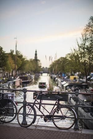 https://imgc.allpostersimages.com/img/posters/the-netherlands-holland-amsterdam-bicycle-on-railing_u-L-Q1EZCRI0.jpg?artPerspective=n
