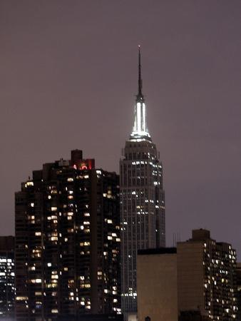 https://imgc.allpostersimages.com/img/posters/the-new-york-city-skyline-is-darker-as-many-buildings-are-conserving-power_u-L-Q10OV8R0.jpg?p=0