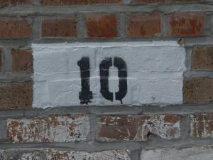 The Number 10 Painted on a Brick Wall