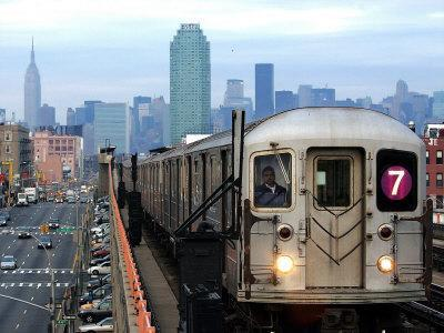 https://imgc.allpostersimages.com/img/posters/the-number-7-train-runs-through-the-queens-borough-of-new-york_u-L-Q10OM1O0.jpg?p=0