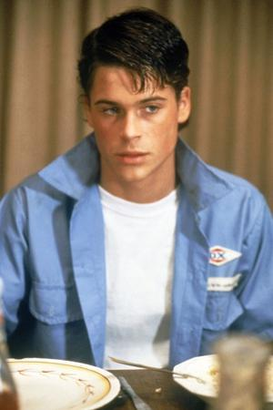 THE OUTSIDERS, 1982 directed by FRANCIS FORD COPPOLA Rob Lowe (photo)