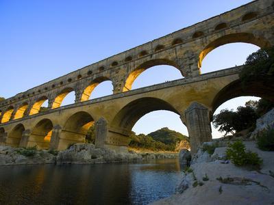 https://imgc.allpostersimages.com/img/posters/the-pont-du-gard-roman-aquaduct-over-the-gard-river-avignon-france_u-L-P248O00.jpg?p=0