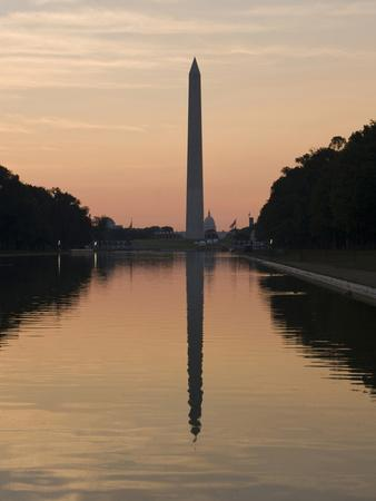 https://imgc.allpostersimages.com/img/posters/the-reflecting-pool-on-the-national-mall-washington-dc-usa-district-of-columbia_u-L-PHALZ20.jpg?artPerspective=n