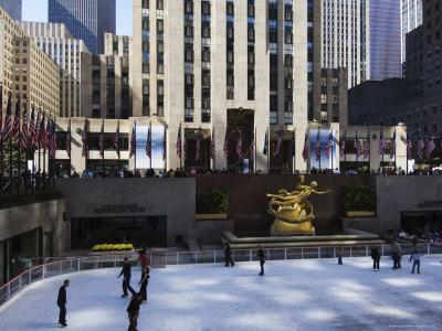 https://imgc.allpostersimages.com/img/posters/the-rockefeller-center-with-famous-ice-rink-in-the-plaza-manhattan-new-york-city-usa_u-L-P1K9480.jpg?p=0