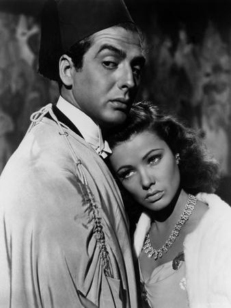 https://imgc.allpostersimages.com/img/posters/the-shanghai-gesture-by-josef-von-sternberg-with-gene-tierney-and-victor-mature-1941-b-w-photo_u-L-Q1C262G0.jpg?artPerspective=n